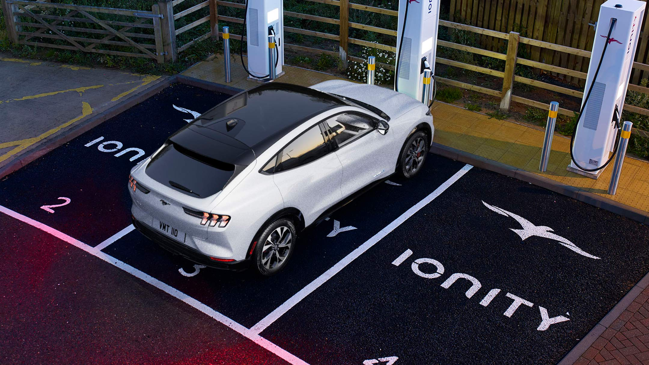 All-New Ford Mustang Mach-E parking and charging in a park