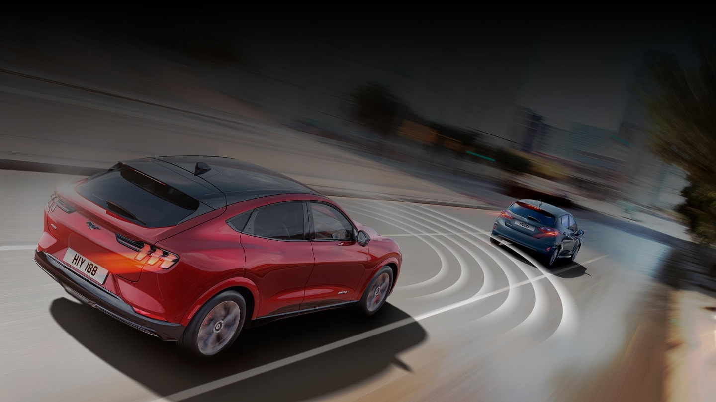 All-New Ford Mustang Mach-E following another car on the road with safety circles indicating one of the technologies